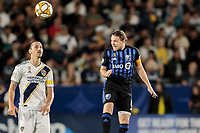 CARSON, CA - SEPTEMBER 21: Samuel Piette #6 of the Montreal Impact heads ball during a game between Montreal Impact and Los Angeles Galaxy at Dignity Health Sports Park on September 21, 2019 in Carson, California.