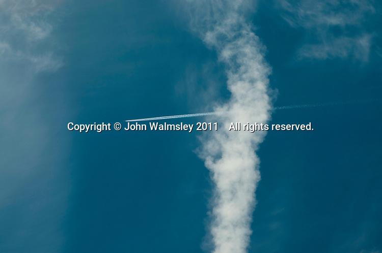 Jet aircraft contrails (condensation trails).