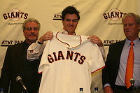 Barry Zito, Brian Sabean and Peter Magowan. Baseball: San Francisco Giants pitcher Barry Zito is introduced to the media at AT&T Park in San Francisco, CA on January 3, 2006. Photo by Brad Mangin