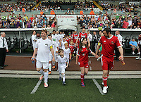 Pictured: Teams Adam Woodyatt (L) and Danny Dyer take to the pitch. Sunday, 01 June 2014<br /> Re: Celebrities v Celebrities football game organised by Sellebrity Scoccer, in aid of Swansea City Community Trust, at the Liberty Stadium, south Wales.