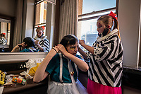 Students of the Cape Town College of Magic Emilie Van Den Hooyen and Maelle Oudejans help each other get ready for a performance at the Artscape Theatre.