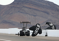 Mar 30, 2014; Las Vegas, NV, USA; A rear view of the parachutes of NHRA top fuel driver Terry McMillen being blown over the wall by the wind during the Summitracing.com Nationals at The Strip at Las Vegas Motor Speedway. Mandatory Credit: Mark J. Rebilas-