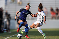 CARY, NC - SEPTEMBER 12: Merritt Mathias #11 of the North Carolina Courage and Sophia Smith #9 of the Portland Thorns FC challenge for the ball during a game between Portland Thorns FC and North Carolina Courage at Sahlen's Stadium at WakeMed Soccer Park on September 12, 2021 in Cary, North Carolina.