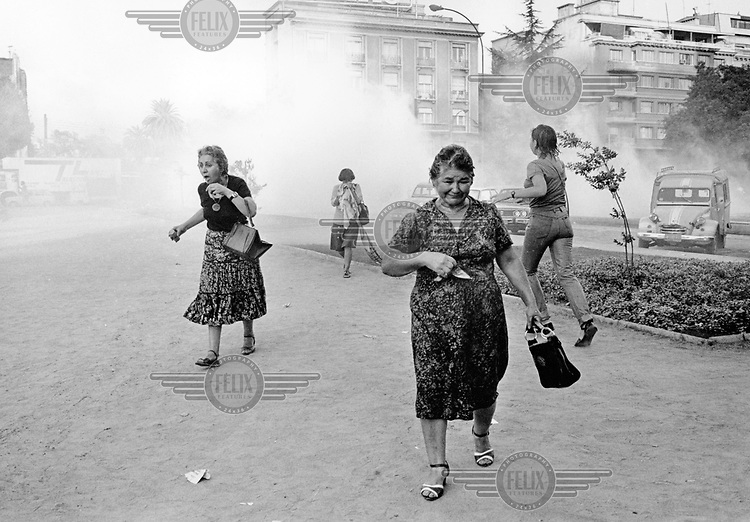 Women protestors are targeted with tear gas during a demonstration against dictator General Pinochet on International Women's Day.