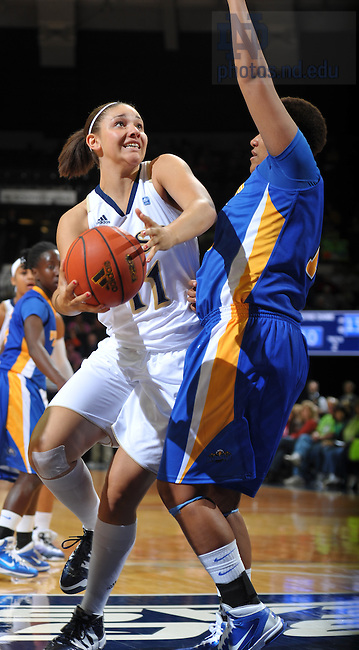 Nov. 15, 2010; Natalie Achonwa (11) attempts to dribble around Morehead State Eagles forward Channing Hillman (1) in the first half at the Purcell Pavilion.<br /> <br /> Photo by Matt Cashore