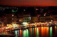 Greece. Western Crete. Chania harbor at dusk