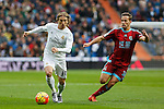 Real Madrid´s Luka Modric (L) and Real Sociedad´s Sergio Canales during La Liga match between Real Madrid and Real Sociedad at Santiago Bernabeu stadium in Madrid, Spain. December 30, 2015. (ALTERPHOTOS/Victor Blanco)