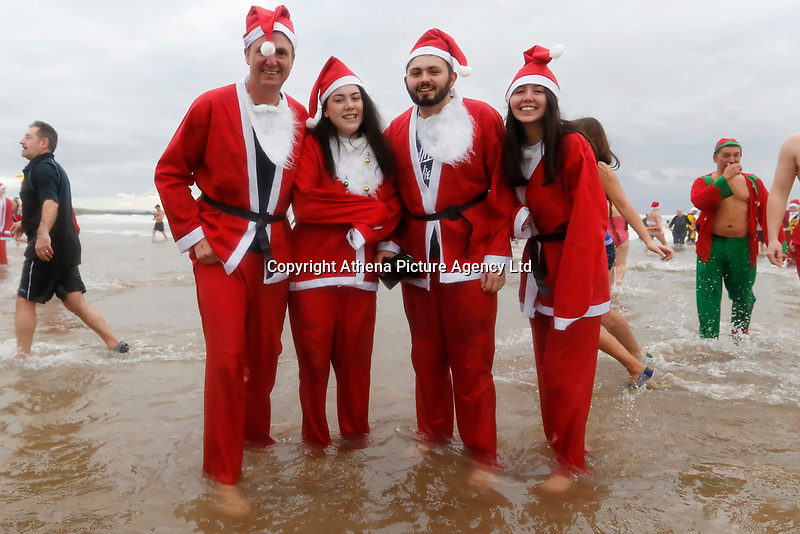 People in Santa outfits