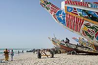MAURETANIA, Nouakchott, atlantic ocean, fishing harbour, coast fisherman, colourful painted wooden boats / MAURETANIEN, Nuakschott, Fischerhafen, atlantischer Ozean, Küstenfischer