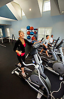 Photography of Charlotte's Berewick community, a planned development located in southwest Charlotte. Image shows residents (model released) working out in the fitness center/weight room.
