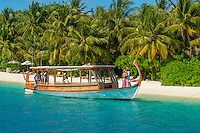 Maldives, Rangali Island. Conrad Hilton Resort. Couple traveling on the transport boat. (MR)