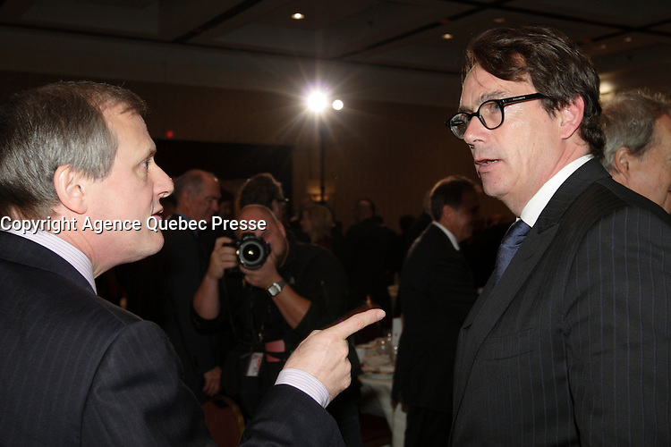 September 26 2012 - Montreal Quebec CANADA - Louis Audet, President & CEO of COGECO et Cogeco Cable,discuss with Pierre-Karl Peladeau, CEO QUEBECOR after speaking at the Canadian Club of Montreal's podium.<br /> <br /> <br /> What is Cogeco? A cable distributor? A broadcaster? No one can claim to truly know this major telecommunications industry player better than its President and CEO, Louis Audet. Under his guidance, Cogeco Cable has become the second-largest cable distribution company in Québec and Ontario, serving nearly 900,000 subscribers from Gaspé to Windsor. Cogeco Cable, through Cogeco Data Services, operates data centres for its business customers in both provinces. Today, Cogeco Diffusion, a COGECO Inc. affiliate company, is a leading Quebec radio broadcaster with 13 stations and provides news services to 47 radio stations across the province. Through Cogeco Métromédia, the company also offers specialized media representation services in the public transit signage sector in major Québec and Canadian cities. In addition, within a very few months Cogeco Cable will expand its cable distribution operations to the United States following its recent acquisition of Atlantic Broadband.