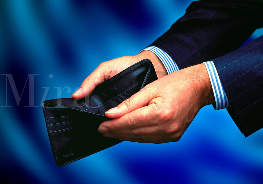 Man showing his empty wallet