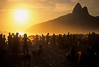 """Sunset at Ipanema beach, Rio de Janeiro, Brazil. Ipanema gained fame with the start of the bossa nova sound, when its residents Antônio Carlos Jobim and Vinícius de Moraes created their ode to their neighborhood, """"Girl from Ipanema."""" The song was written in 1962, with music by Jobim and Portuguese lyrics by de Moraes with English lyrics written later by Norman Gimbel. The beach is famously known for its elegance and social qualities."""