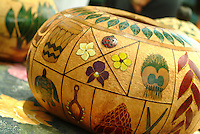 Gourd or bowl with intricate Hawaiian designs at a craft fair on Lei Day.