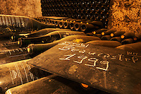 Old and dusty bottles, big jeroboam size, of Chateauneuf-du-Pape 1999 in the wine cellar written on a chalk board. Chateau de Beaucastel, Domaines Perrin, Courthézon Courthezon Vaucluse France Europe