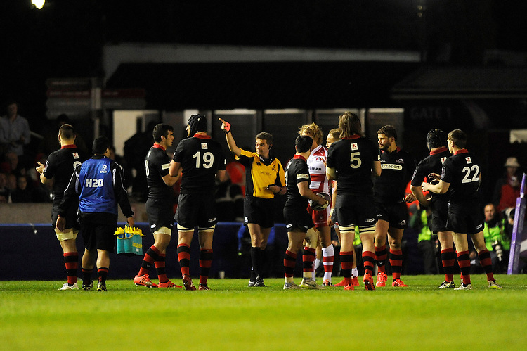 Referee Jerome Garces awards a red card to Bill Meakes of Gloucester Rugby