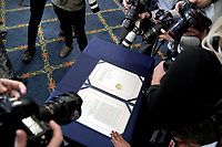 Photographers make pictures of H.R. 24, an article of impeachment against President Donald Trump, after an engrossment ceremony on Wednesday, January 13, 2021 at the U.S. Capitol.<br /> Credit: Greg Nash / Pool via CNP /MediaPunch