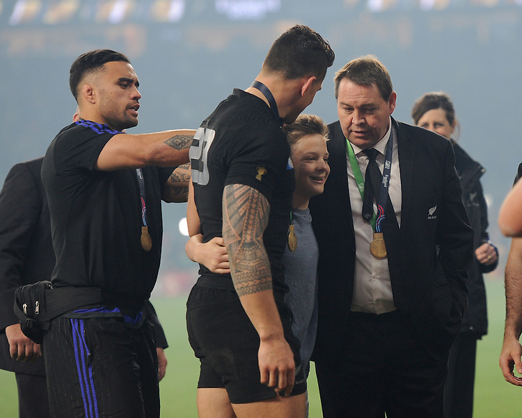 Sonny Bill Williams and Steve Hansen, New Zealand Head Coach, with All Blacks' fan Charlie Lines, to whom he gave his RWC winners' medal during the Rugby World Cup Final between New Zealand and Australia - 31/10/2015 - Twickenham Stadium, London<br /> Mandatory Credit: Rob Munro/Stewart Communications