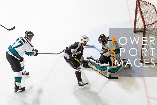 Patrick Ruiz of Nordic Vikings (C) battle in the goal mouth with Cathay Flyers Goalie Jasen Await (R) during the Mega Ice Hockey 5s match between Cathay Flyers and Nordic Vikings on May 03, 2018 in Hong Kong, Hong Kong. Photo by Marcio Rodrigo Machado / Power Sport Images
