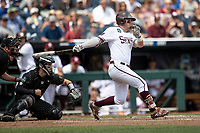 Mississippi State Bulldogs first baseman Tanner Allen (5) follows through on his swing during Game 8 of the NCAA College World Series against the Vanderbilt Commodores on June 19, 2019 at TD Ameritrade Park in Omaha, Nebraska. Vanderbilt defeated Mississippi State 6-3. (Andrew Woolley/Four Seam Images)