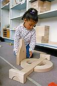 MR/Schenectady, New York.Yates Arts-in-Education Magnet School/ Pre-Kindergarten.[Universal Pre-Kindergarten Program] .Student builds with blocks at free-time. (Girl: 4, Puerto-Rican/Ecuadorian-American).MR:Lup1.PN#:26271      FC#:24208-00207.scan from slide.© Ellen B. Senisi