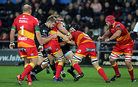 James King of the Ospreys (C) is held back by Dragons players during the Guinness PRO14 match between Ospreys and Dragons at The Liberty Stadium, Swansea, Wales, UK. Friday 27 October 2017