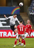 19th December 2020; Liberty Stadium, Swansea, Glamorgan, Wales; English Football League Championship Football, Swansea City versus Barnsley; Connor Roberts of Swansea City heads the ball clear