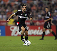 30 October,  2004.   DC United's Ben Olsen (14) looks for room to run during the 2004 MLS playoffs at RFK Stadium in Washington, DC.