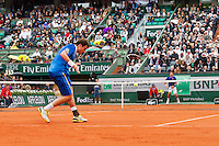 30-05-13, Tennis, France, Paris, Roland Garros,  Novak Djokovic vs  Guido Fella on court Philippe Chatrier(centercourt)