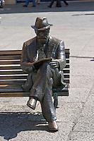 statue of Antoni Gaudi on bench in front of Casa de los Botines, Plaza San Marcelo, Leon spain castile and leon