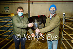Colm O'Connor (left) winner of the best butcher heifer and angus heifer and the cup been presented by Aidan Dillon in the Tralee Annual Christmas Show and Sale Mart on Monday