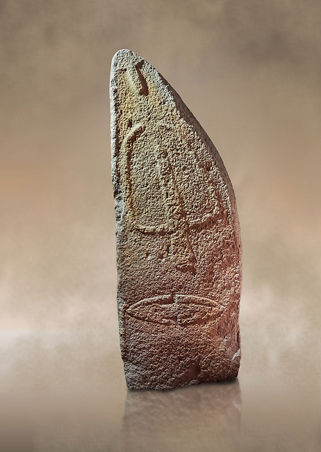 Late European Neolithic prehistoric Menhir standing stone with carvings on its face side. The representation of a stylalised male figure starts at the top with a long nose from which 2 eyebrows arch around the top of the stone. below this is a carving of a falling figure with head at the bottom and 2 curved arms encircling a body above. at the bottom is a carving of a dagger running horizontally across the menhir. Excavated from Pranu Maore I site,  Laconi. Menhir Museum, Museo della Statuaria Prehistorica in Sardegna, Museum of Prehoistoric Sardinian Statues, Palazzo Aymerich, Laconi, Sardinia, Italy