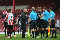 Charlton Athletic Manager, Lee Bowyer, speaks to match referee, Mr John Brooks, at the final whistle during Brentford vs Charlton Athletic, Sky Bet EFL Championship Football at Griffin Park on 7th July 2020