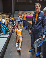 13 April, 2016, France, Trélazé, Arena Loire,   Semifinal FedCup, France-Netherlands, Dutch team warming up, in the middle Arantxa Rus and right captain Paul Haarhuis<br /> Photo:Tennisimages/Henk Koster