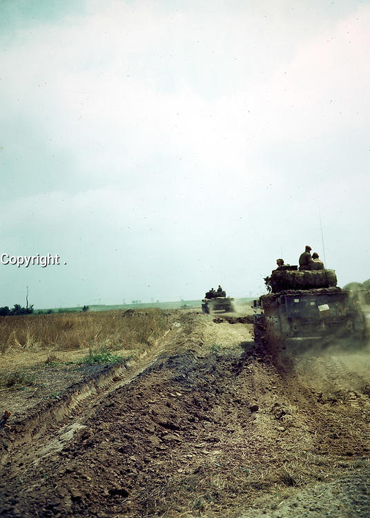 Summer 1944 file Photo - Caen, FRANCE - Canadian army tanks south of Caens