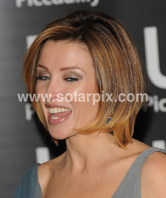 **ALL ROUND PICTURES FROM SOLARPIX.COM**                                             **WORLDWIDE SYNDICATION RIGHTS**                                                                                  Caption:    Dannii Minogue meets the fans and signs her book, Dannii: My Story.  Held at Waterstones, Picadilly, London, on Friday October 29, 2010.                                                                           This pic:     Dannii Minogue                                                                                         JOB REF:   12409     SSD       DATE:   29.10.10                                                         **MUST CREDIT SOLARPIX.COM OR DOUBLE FEE WILL BE CHARGED**                                                                      **MUST AGREE FEE BEFORE ONLINE USAGE**                               **CALL US ON: +34 952 811 768 or LOW RATE FROM UK 0844 617 7637**