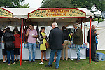 Barnet Gypsy Horse Fair Hertfordshire UK. Sam Bilton tea stall  old fashioned sign,  claims that he only uses the best cows milk .
