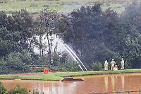 Pictured:  Firemen douse the train with water in Llangennech, Wales, UK. Thursday 27 August 2020<br /> Re: A freight train carrying diesel has derailed and burst into flames in Llangennech, near Llanelli, Wales, UK.<br /> People living nearby in Carmarthenshire, were evacuated but have since returned to their homes.<br /> Police declared a major incident, put a cordon in place and closed roads.<br /> The two workers who were on board the train have been accounted for and no injuries have been reported according  to the British Transport Police.