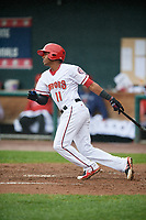 Harrisburg Senators second baseman Osvaldo Abreu (11) follows through on a swing during a game against the Akron RubberDucks on August 19, 2018 at FNB Field in Harrisburg, Pennsylvania.  Akron defeated Harrisburg 3-0 in a rain shortened game.  (Mike Janes/Four Seam Images)