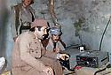 Iraq 1979  <br /> Left, Talat Gulli, engineer, fixing the radio the Voice of Kurdistan in Nawzang<br /> Iraq 1979<br /> A gauche, Talat Gulli, ingenieur, installant a Nawzang dans les montagnes la radio: the Voice of Kurdistan