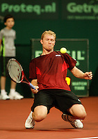 10-2-06, Netherlands, tennis, Amsterdam, Daviscup.Netherlands Russia, Dmitry Tursonov  gets a ball on his body and goes to the floor in his match against Raemon Sluiteri