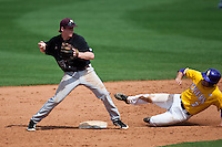 Mississippi State Bulldog second baseman Matthew Britton #15 turns a double play during the NCAA baseball game against the LSU Tigers on March 18, 2012 at Alex Box Stadium in Baton Rouge, Louisiana. LSU defeated Mississippi State 4-2. (Andrew Woolley / Four Seam Images).