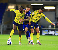 28th September 2021; Cardiff City Stadium, Cardiff, Wales;  EFL Championship football, Cardiff versus West Bromwich Albion; Semi Ajayi and Jake Livermore of West Bromwich Albion challenge James Collins of Cardiff City