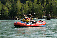 Nick Lynch and Kirsten Olsen take a relax during a slow stretch of the upper Kenai River.