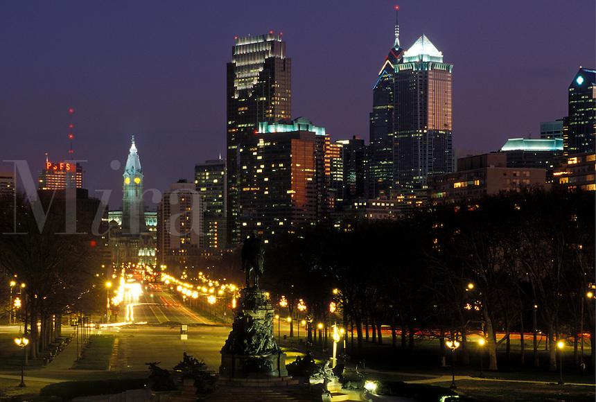 Philadelphia, PA, Pennsylvania, Skyline of downtown Philadelphia and Benjamin Franklin Parkway in the evening.