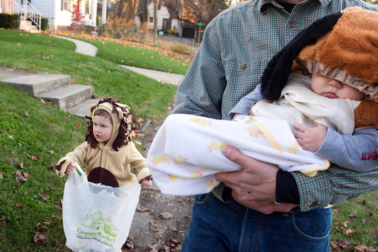My younger son first went trick-or-treating at five months old as a dog, while his three-year-old brother was a lion. My husband escorts them.