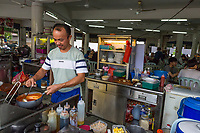 Small Individual Kitchens Surround Common Shared Dining Area in Local Casual Restaurant, Ipoh, Malaysia.