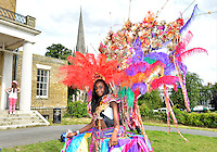 July 21, 2012: Member of a local dance group pose for a photograph before the arrival of Olympic Torch at Clissold Park in the town of Stoke Newington, London, England.