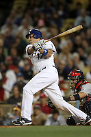 A.J. Ellis #17 of the Los Angeles Dodgers bats against the St.Louis Cardinals at Dodger Stadium on May 18, 2012 in Los Angeles,California. Los Angeles defeated St.Louis 6-5.(Larry Goren/Four Seam Images)